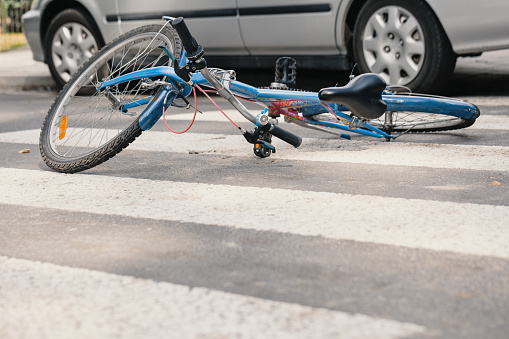 Blue bike on a pedestrian crossing after fatal accident with a car