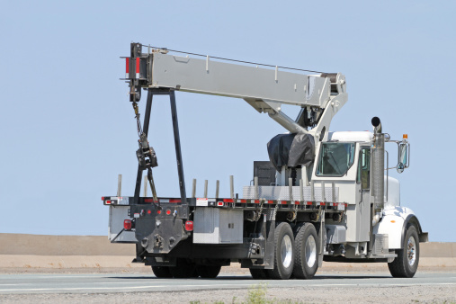 Truck mounted, extendable hydraulic crane commonly used for transporting and placing materials and supplies.